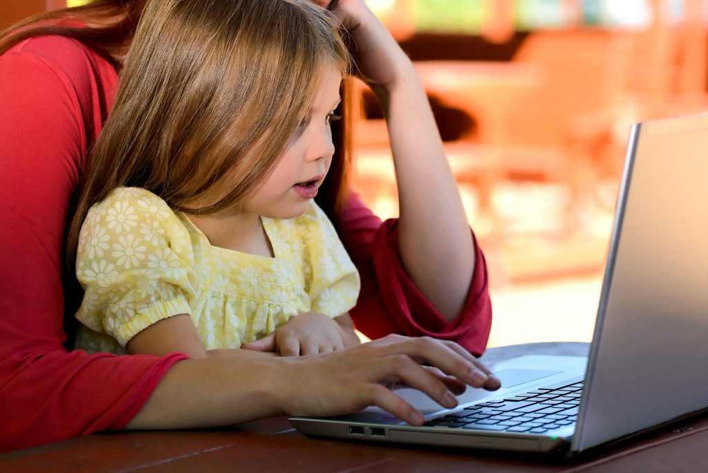 Child and parent at computer