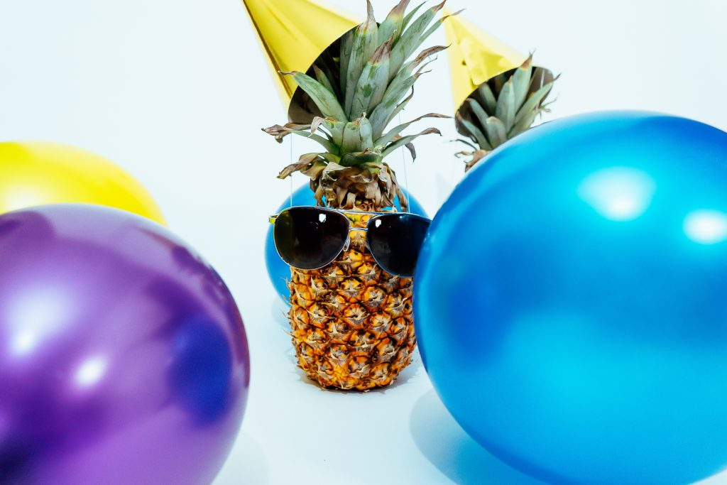 Pineapple with sunglasses and party hat