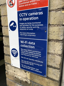 warning showing wifi collection by london's TFL at a tube station